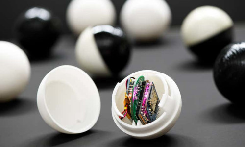 One of the robotic balls opened up, showing its circuit boards